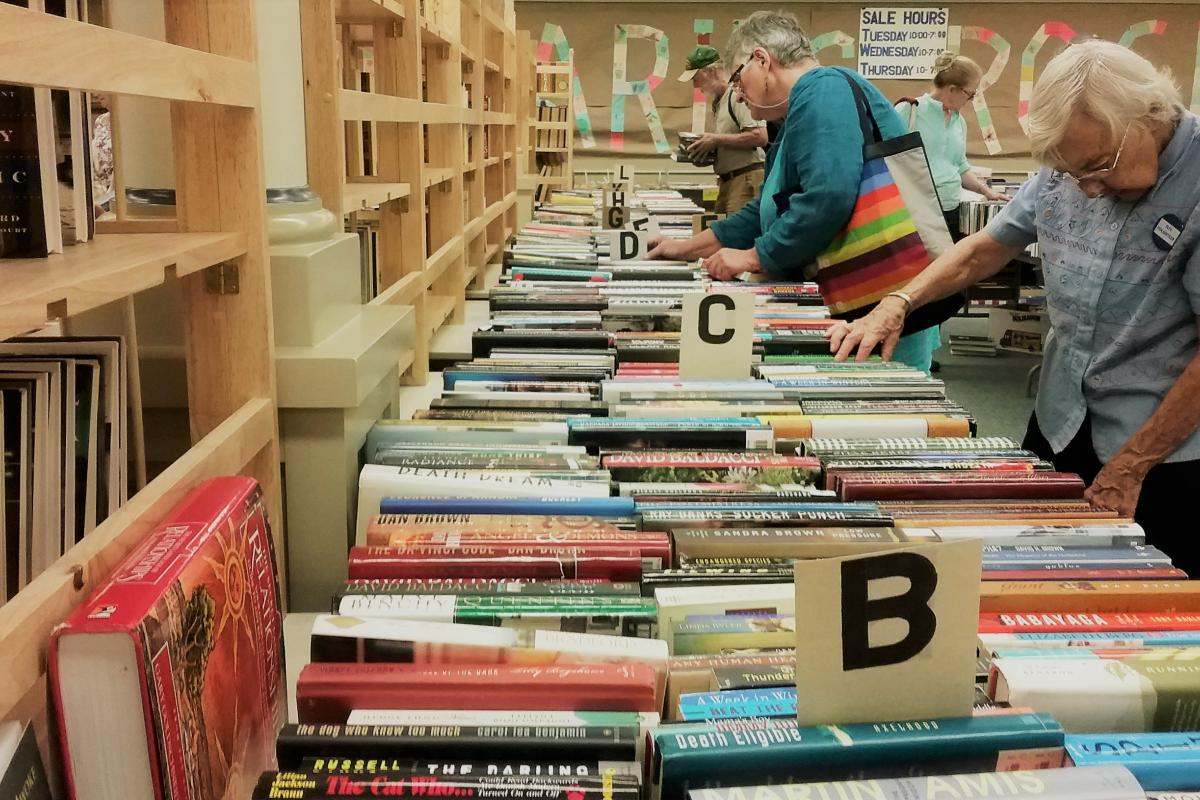 Patrons peruse the offerings at the Summer Book Sale